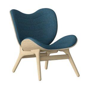 a conversation piece lænestol med lav ryg i eg og sæde i petrol blue fra umage
