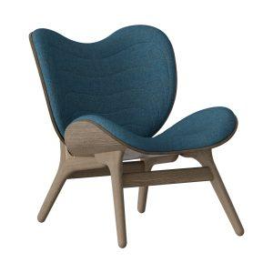 a conversation piece lænestol med lav ryg i mørk eg og sæde i petrol blue fra umage